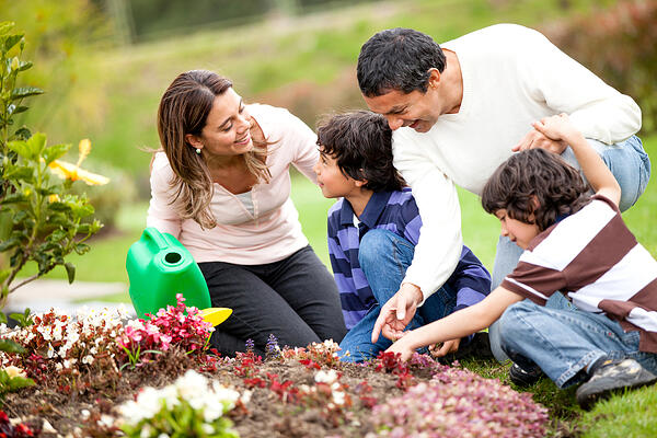 Happy family gardening together and taking care of nature-1
