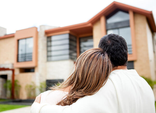 Loving couple looking at their dream house-1